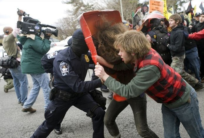 Liberals fighting with police