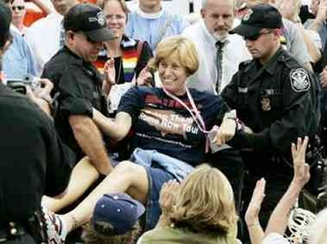 Cindy Sheehan being arrested and happy about it