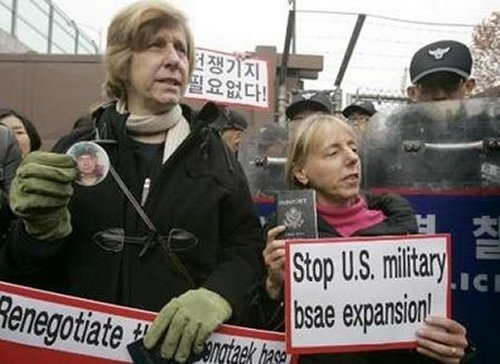 Medea Benjamin and Cindy Sheehan protesting in North Korea