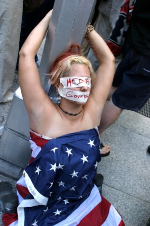 Another Useless Liberal Protester Disrespecting the Flag