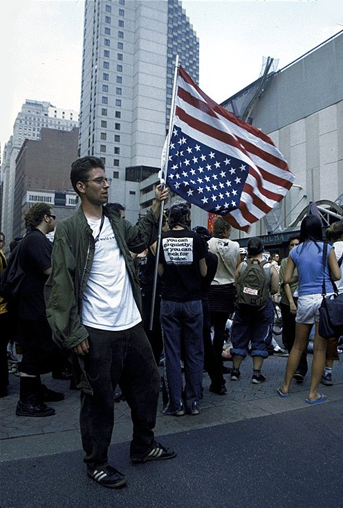 A Liberal Protester Disrespecting the Flag